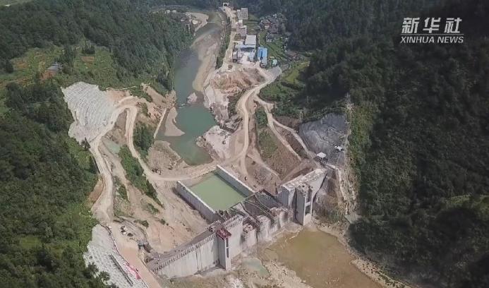 新華微視∣扶貧重點工程空寨水庫大壩順利封頂